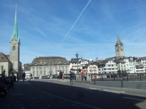 pretty spire and buildings, with blue sky in Zurich